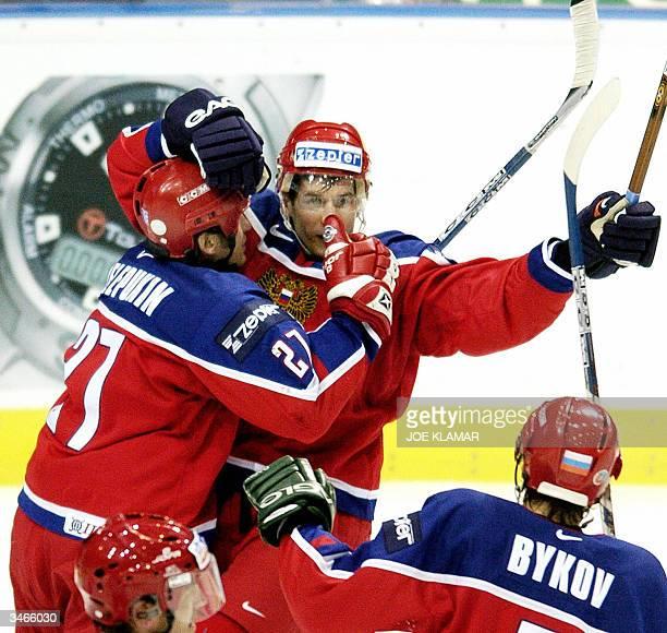 Valeri Zelepukin , Alexei Yashin , and Dmitri Bykov celebrate Yashin's first goal to 1:0 against Denmark during the group C preliminary round in the...