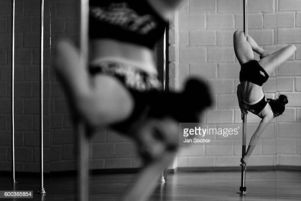 Valeria Aboultaif a young Colombian pole dancer performs during a pole dance training session at Academia Pin Up on March 02 2016 in Medellin...