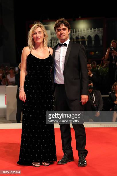 Valeria Bruni Tedeschi and Riccardo Scamarcio walk the red carpet ahead of the The Summer House screening during the 75th Venice Film Festival at...