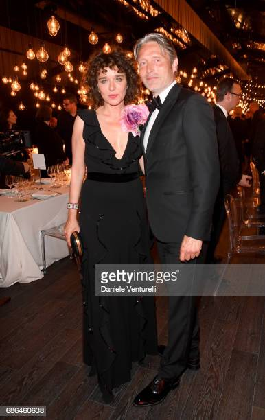Valeria Golino and Mads Mikkelsen attend the Women in Motion Awards Dinner at the 70th Cannes Film Festival at Place de la Castre on May 21 2017 in...