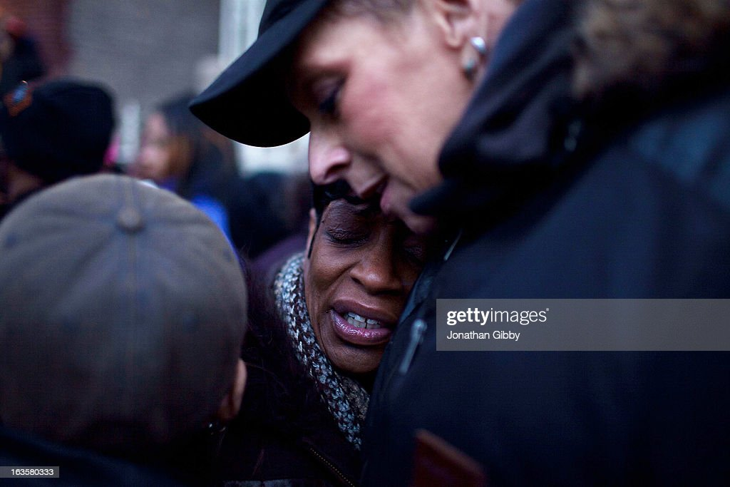 Valeria Hanks (C), the great aunt of slain infant Jonylah Watkins, mourns during a vigil on March 12, 2013 in Chicago, Illinois. The 6-month-old girl was shot five times on the 6500 block of South Maryland Avenue while her father was changing her diaper in the passenger seat of his car. The father, Jonathan Watkins remains is stable condition at Nothwestern Memorial Hospital after receiving three gunshot wounds.