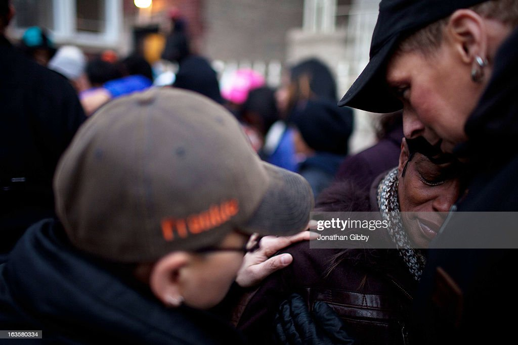 Valeria Hanks (R), the great aunt of slain infant Jonylah Watkins, mourns during a vigil on March 12, 2013 in Chicago, Illinois. The 6-month-old girl was shot five times on the 6500 block of South Maryland Avenue while her father was changing her diaper in the passenger seat of his car. The father, Jonathan Watkins remains is stable condition at Nothwestern Memorial Hospital after receiving three gunshot wounds.