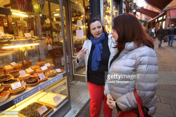 Valeria Hensemberger takes visiting tourist Nava Goldstein shopping at the Quadrilatero market ahead of a cooking lesson at Il Salotto di Penelope on...