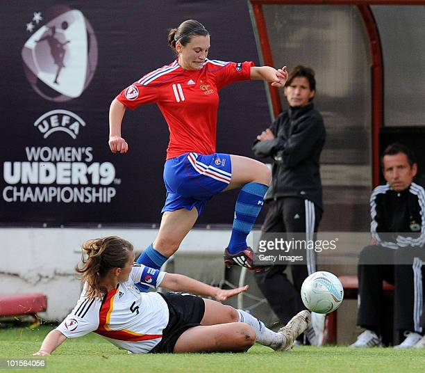 Valeria Kleiner of Germany fights for the ball with France player Lea Le Garrec during the UEFA Women's Under19 European Championshipsemifinal match...