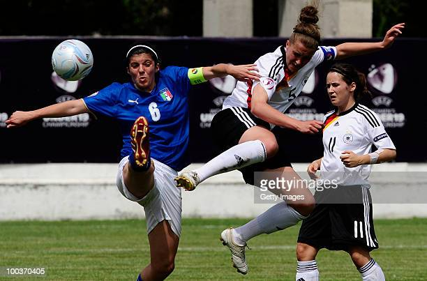 Valeria Klener of Germany fights for the ball with Francesca Sanpetro of Italy during the UEFA Women's Under19 European Championship group A match...