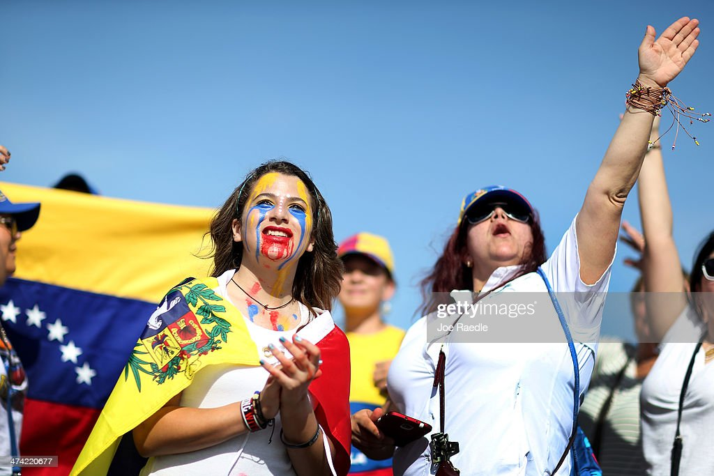 Valeria Moran (L) joins with other Venezuelans and their supporters as they show their support with the anti-government protests in Venezuela on February 22, 2014 in Doral, Florida. In Venezuela, protests over the past couple of weeks have resulted in violence as government opponents and supporters have faced off in the streets.