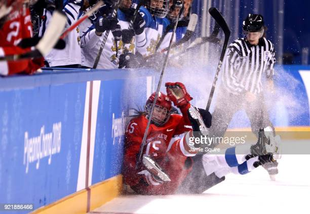 Valeria Pavlova of Olympic Athlete from Russia and Minnamari Tuominen of Finland collide in the first period during the Women's Ice Hockey Bronze...