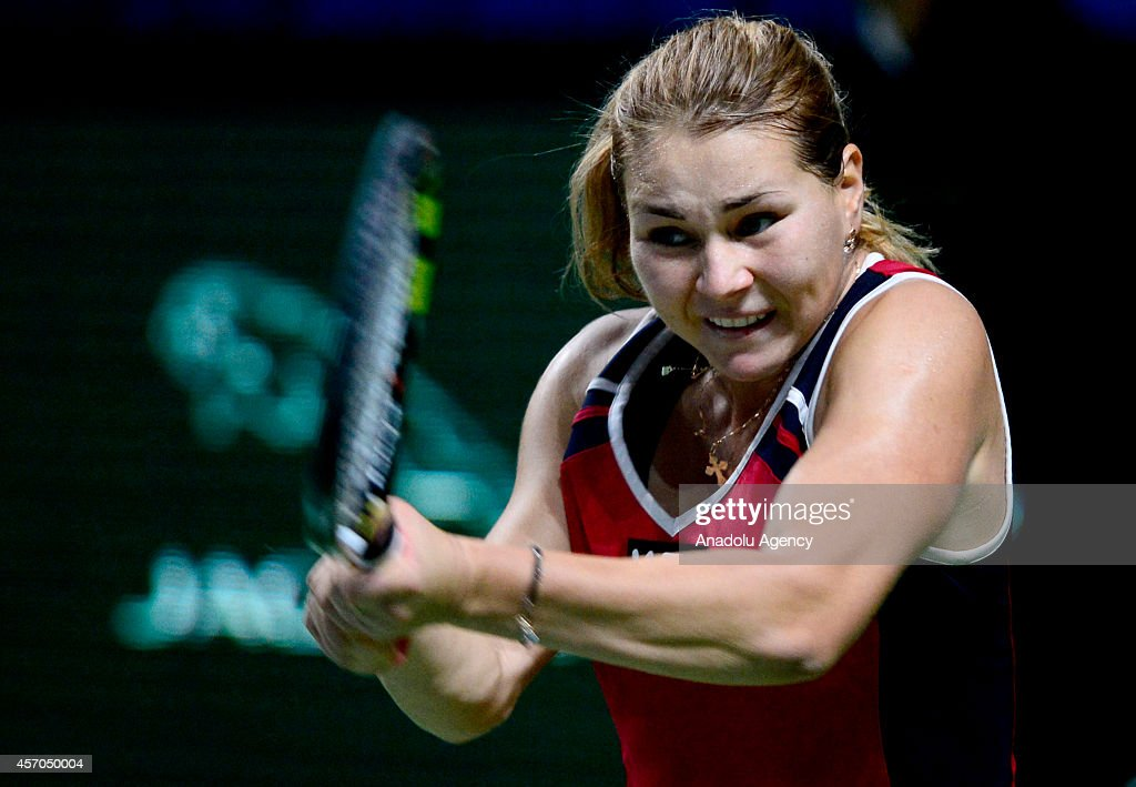 Valeria Solovyeva of Russia returns a shot against Kateryna Kozlova of Ukraine during the Women's singles on the first day of Kremlin Cup 2014 25th International Tennis Tournament at the Olympic Stadium in Moscow, Russia, on October 11, 2014.