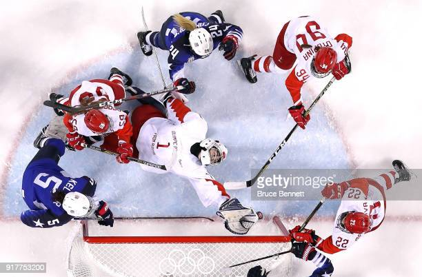 Valeria Tarakanova of Olympic Athlete from Russia lies on the ice as she attempts to make a save in the second period against the United States...