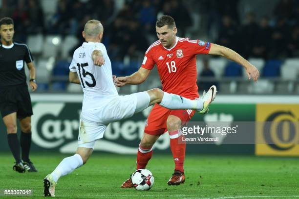 Valerian Gvilia of Georgia tackles Sam Vokes of Wales in action during the FIFA 2018 World Cup Qualifier between Georgia and Wales at Boris Paichadze...