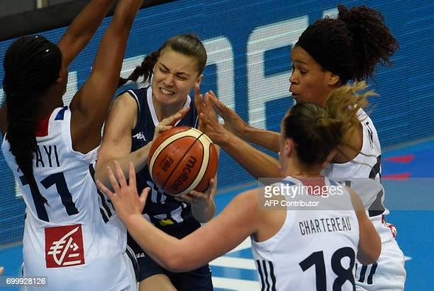 Valeriane Ayayi and Alexia Chartereau of France try to block Barbora Balintova of Slovakia during the FIBA EuroBasket 2017 women's quarterfinal match...