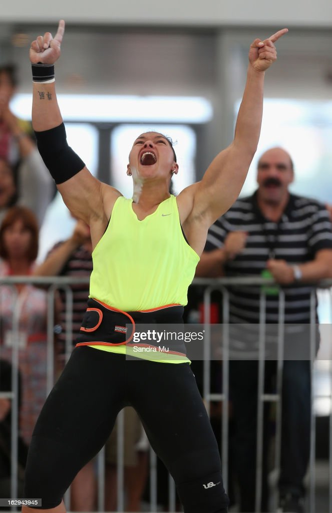 Valerie Adams celebrates her Oceania record with coach Jean-Pierre Egger looking on (R) as she competes in The Shot In The City at The Cloud on Queen's Wharf on March 2, 2013 in Auckland, New Zealand.
