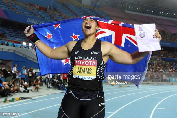 Valerie Adams of New Zealand celebrates with her country's flag after winning the women's shot put final during day three of the 13th IAAF World...