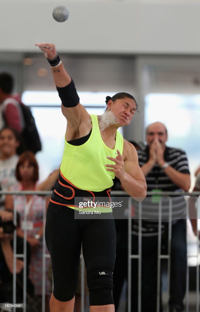 Valerie Adams throws an Oceania record as coach Jean-Pierre Egger looks on (R) during The Shot In The City at The Cloud on Queen's Wharf on March 2, 2013 in Auckland, New Zealand.