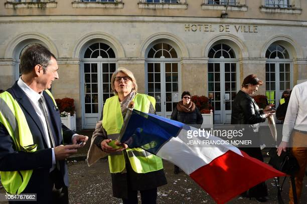 'Valerie' and 'Philippe' who are about to be married wear yellow vests and wave the tricolor after being encouraged to do so by yellow vest...