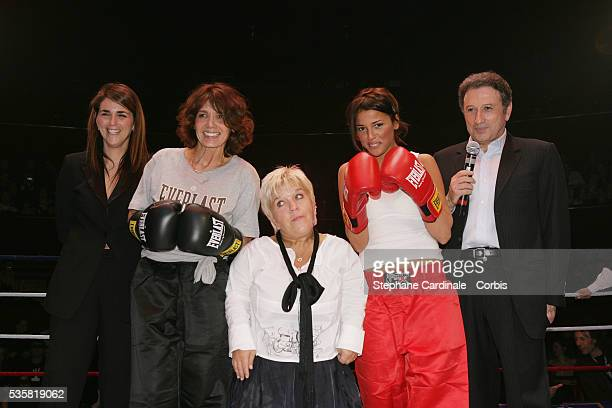 Valerie Benaim, Stephanie Fugain, Mimie Mathy, Nadyia and host Michel Drucker pose in the ring during the 2005 Gala du Ring organised by the First...