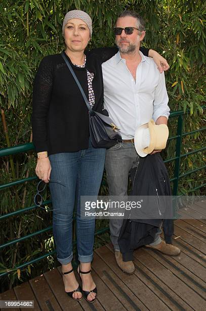 Valerie Benguigui and her Husband sighting during the French Open at Roland Garros on June 5 2013 in Paris France