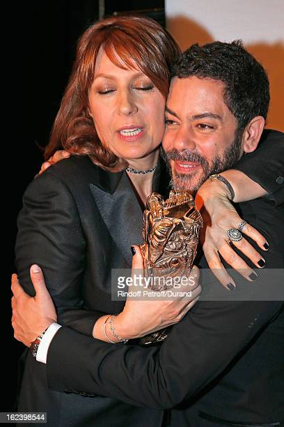 Valerie Benguigui poses backstage with Manu Payet holding the best supporting actress Cesar award she received for Le Prenom during the Cesar Film...