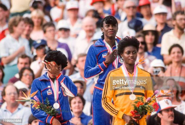 Valerie BriscoHooks and Florence Griffith Joyner of the United States and Merlene OtteyPage of Jamaica receive their Olympic medals for the Women's...