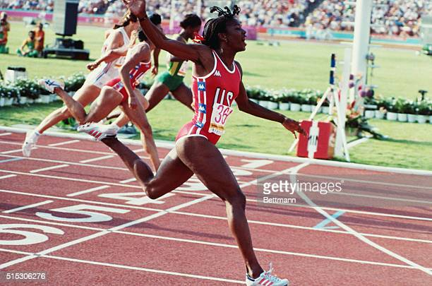 Valerie Brisco-Hooks of the USA moves into the lead to win the gold in the women's 400 meter final Monday. Kathryn Cook of Britain won the bronze,...