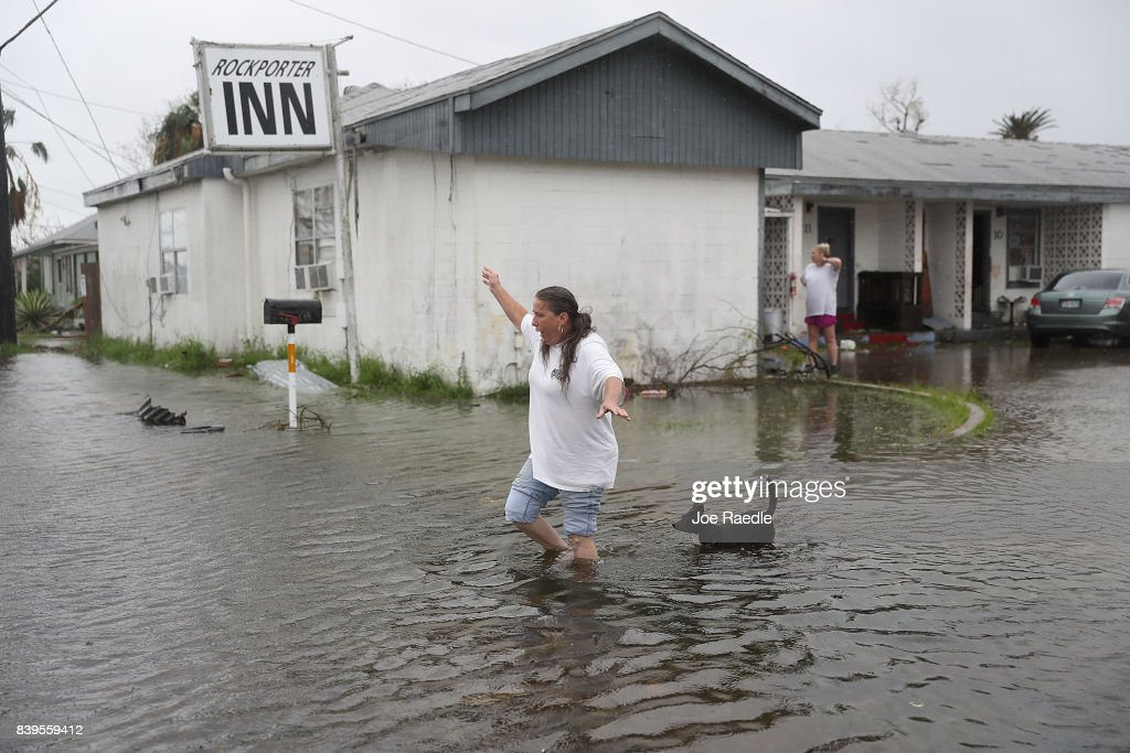 Valerie Brown walks through a flooded area after leaving the apartment that she road out Hurricane Harvey in on August 26, 2017 in Rockport, Texas. Harvey made landfall shortly after 11 p.m. Friday, just north of Port Aransas as a Category 4 storm and is being reported as the strongest hurricane to hit the United States since Wilma in 2005. Forecasts call for as much as 30 inches of rain to fall in the next few days.