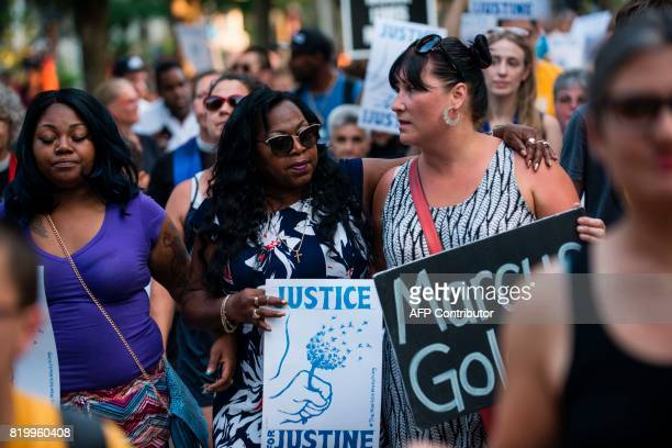 Valerie Castile center mother of Philando Castile who was killed by a police officer last year marches in memory of Justine Damond on July 20 2017 in...