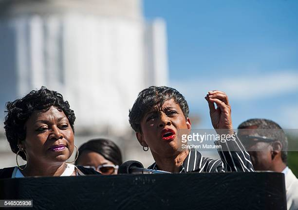 Valerie Castile left mother of Philando Castile and Judge Glenda Hatchett take questions at a press conference on July 12 2016 in St Paul Minnesota...
