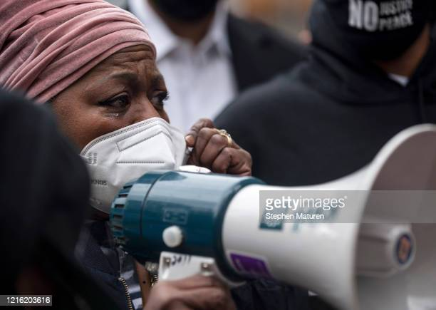 Valerie Castile, mother of Philando Castile, speaks at a protest with Former NBA player Stephen Jackson outside the Hennepin County Government Center...