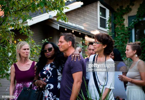 Valerie Castile the mother of Philando Castile embraces Don Damond the fiance of Justine Damond outside his home on July 20 2017 in Minneapolis...