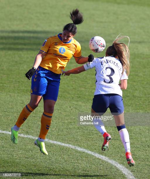 Valerie Gauvin of Everton and Shelina Zadorsky of Tottenham Hotspur compete in the air during the Barclays FA Women's Super League match between...