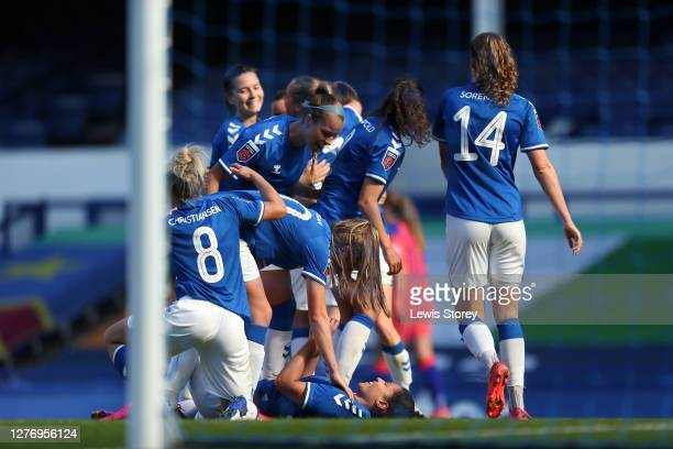 Valerie Gauvin of Everton celebrates with teammates after scoring her sides second goal during the Women's FA Cup Quarter Final match between Everton...