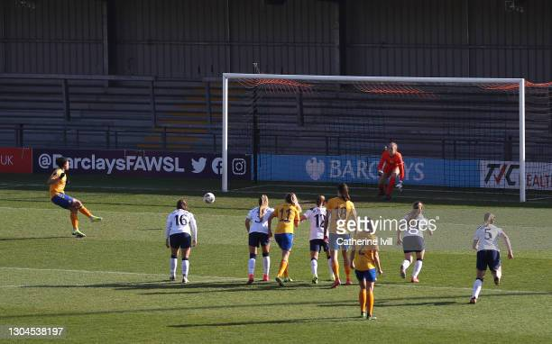 Valerie Gauvin of Everton scores their side's first goal from the penalty spot past Aurora Milkalsen of Tottenham Hotspur during the Barclays FA...