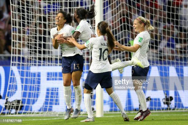 Valerie Gauvin of France celebrates with teammates after scoring her team's first goal during the 2019 FIFA Women's World Cup France Round Of 16...