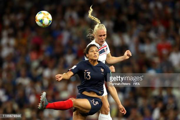 Valerie Gauvin of France competes for a header with Maria Thorisdottir of Norway during the 2019 FIFA Women's World Cup France group A match between...