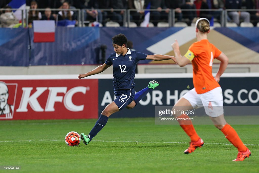 Valerie Gauvin #12 of France controls the ball against Mandy van den Berg #4 of Netherlands during the international friendly game between France and Netherlands at Stade Jean Bouin on October 23, 2015 in Paris, France.