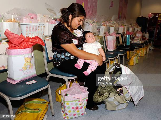 Valerie Gomez holds her two monthold daughter Eliana Gomez during a baby shower held at Nellis Air Force Base for new and expectant mothers who have...