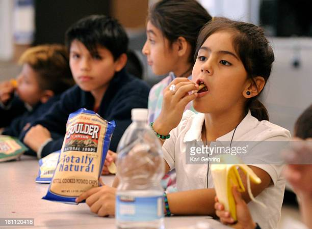 Valerie Gomez right age 8 enjoyed a snack as the after school program got under way Friday About twenty kids took part in the afterschool program at...