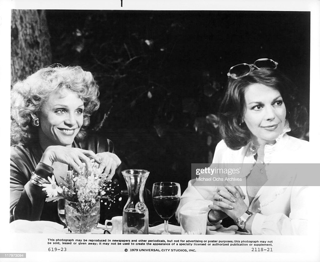 Valerie Harper and Natalie Wood flirt with two single men in a scene from the film 'The Last Married Couple in America', 1980.