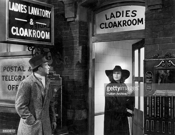 Valerie Hobson enters a Ladies Cloakroom while Conrad Veidt waits outside in a scene from 'Contraband' directed by Michael Powell and produced by...