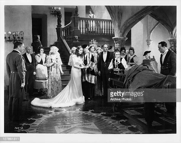 Valerie Hobson with astonished group as monster is revealed in a scene from the film 'Bride Of Frankenstein' 1935