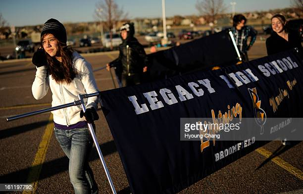 Valerie Jargon front left and Samantha Swain prepares the banner of the Legacy High School Lightning Band for the practice at the school in...