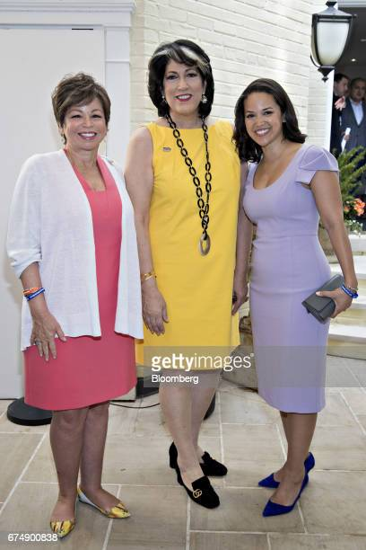 Valerie Jarrett former senior advisor to US President Barack Obama left her daughter Laura Jarrett right and Tammy Haddad president and chief...