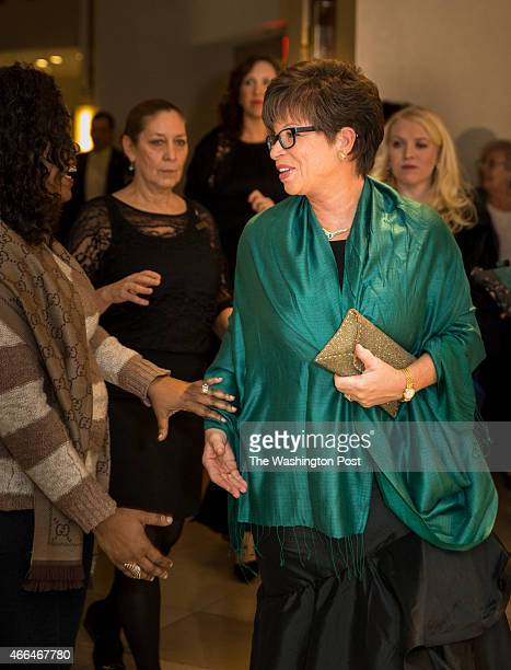 Valerie Jarrett greets a fan on her way into the Gridiron Club Dinner at the Renaissance Hotel in Washington DC on March 14 2015 The annual dinner is...