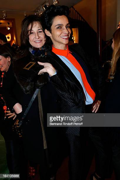 Valerie Lemercier and Farida Khelfa attend Vincent Darre Exhibition opening at Galerie Pierre Passebon on March 19 2013 in Paris France
