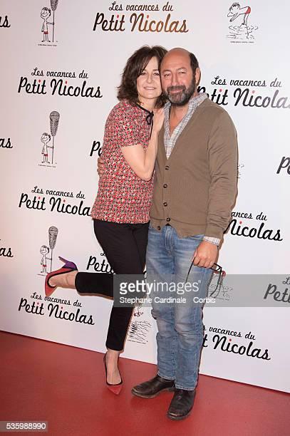 Valerie Lemercier and Kad Merad attend the 'les vacances du petit Nicolas' Premiere at Cinema Gaumont Capucine in Paris