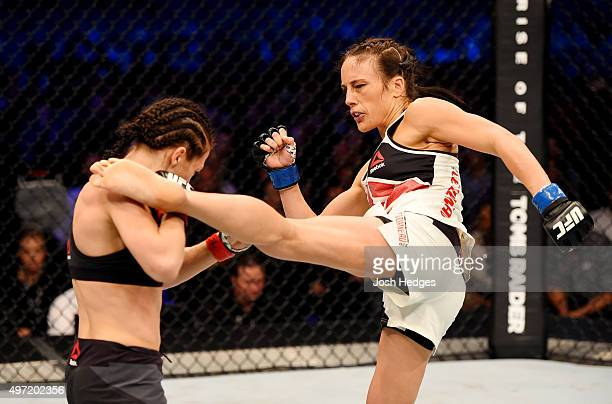 Valerie Letourneau lands a leftleg kick against Joanna Jedrzejczyk in their UFC women's strawweight championship bout during the UFC 193 event at...