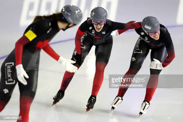 Valerie Maltais, Ivanie Blondin and Isabelle Weidemann of Canada celebrate after they compete in the Team Pursuit Women during the ISU World Cup...