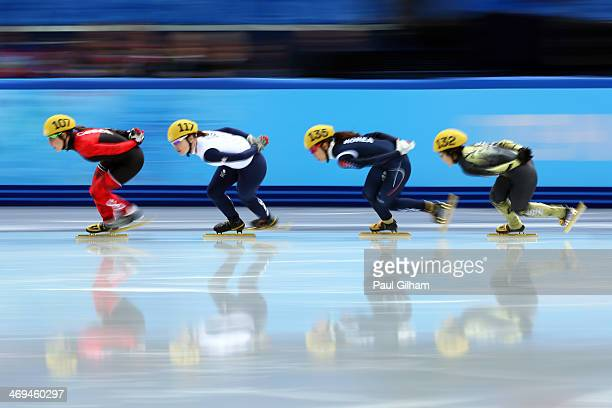Valerie Maltais of Canada Charlotte Gilmartin of Great Britain HaRi Cho of South Korea and Biba Sakurai of Japan skate during the Ladies' 1500m Short...