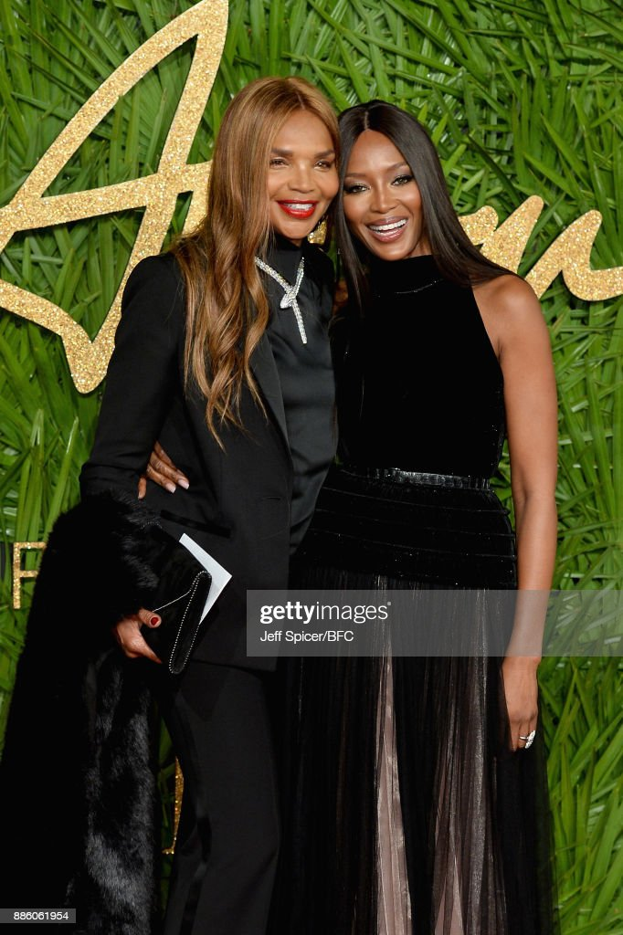 Valerie Morris and model Naomi Campbell walk the carpet during The Fashion Awards 2017 in partnership with Swarovski at Royal Albert Hall on December 4, 2017 in London, England.