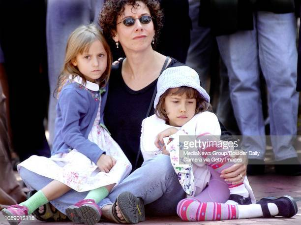 Valerie NelsonGrant center holds her fiveyearold twins Bailey left and Claire during a ceremony Wednesday on the Pearl Street Mall near 13th street...